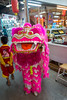 Young dancers doing the Dragon Dance to celebrate Chinese New Year at the Kalare Night Bazaar, Chiang Mai, Thailand.