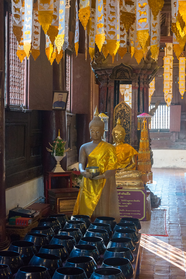 Wat Phan Tao (วัดพันเตา) Intricate teak Buddhist temple with gilded accents & colorful mosaics, founded in the 14th century.Chiang Mai, Thailand.