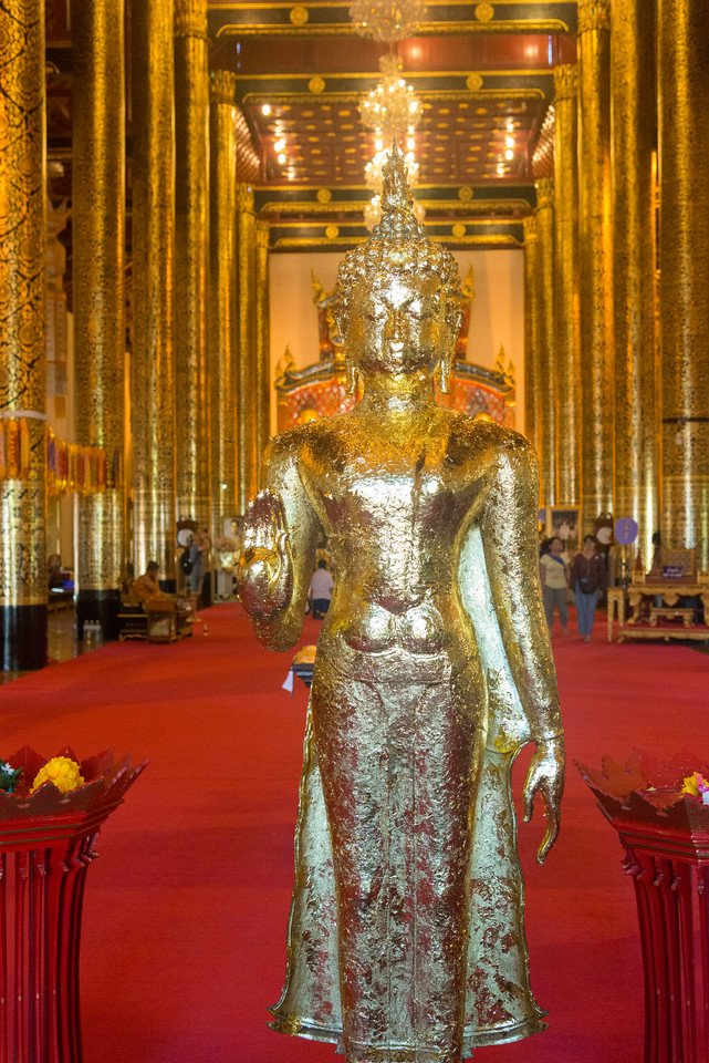Golden Buddha statue at Wat Chedi Luang (วัดเจดีย์หลวง). In a wihan near the entrance to the temple is the Buddha statue named Phra Chao Attarot (Eighteen-cubit Buddha), which was cast in the late 14th century. On the other side of the chedi is another pavilion housing a reclining Buddha statue. Wat Chedi Luang is a Buddhist temple in the historic centre of Chiang Mai, Thailand. The current temple grounds were originally made up of three temples — Wat Chedi Luang, Wat Ho Tham and Wat Sukmin. Chiang Mai, Thailand.