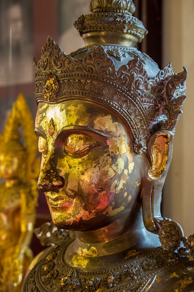 Many golden Buddha statues inside Wat Phra Singh Woramahawihan (วัดพระสิงห์วรมหาวิหาร ), 14th-century Buddhist temple boasting gold & copper Buddhas, murals & ancient manuscripts.Chiang Mai, Thailand.