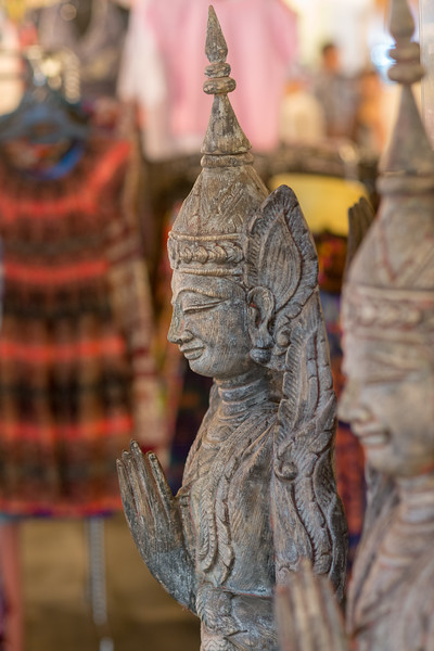 Various buddhist and other items on sale at the Kalare Night Bazaar, Chiang Mai, Thailand.