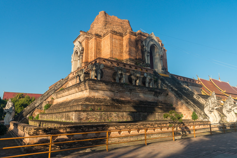 Wat Chedi Luang (วัดเจดีย์หลวง) (temple of the big stupa or temple of the royal stupa). The construction of the temple started in the 14th century, when King Saen Muang Ma planned to bury the ashes of his father there. After 10 years of building time it was left unfinished, later to be continued after the death of the king by his widow. Wat Chedi Luang is a Buddhist temple in the historic centre of Chiang Mai, Thailand. The current temple grounds were originally made up of three temples — Wat Chedi Luang, Wat Ho Tham and Wat Sukmin. Chiang Mai, Thailand.