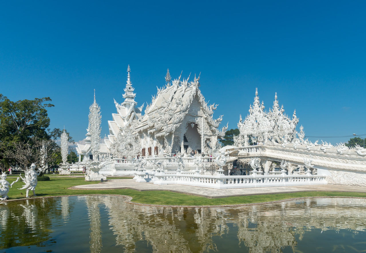Wat Rong Khun White Temple (วัดร่องขุ่น) <br /> Contemporary Buddhist temple drawing massive crowds with its unique, intricate white exterior. Wat Rong Khun, also known as the White Temple, is a contemporary, unconventional, privately-owned art exhibit in the style of a Buddhist temple in Chiang Rai Province, Thailand.