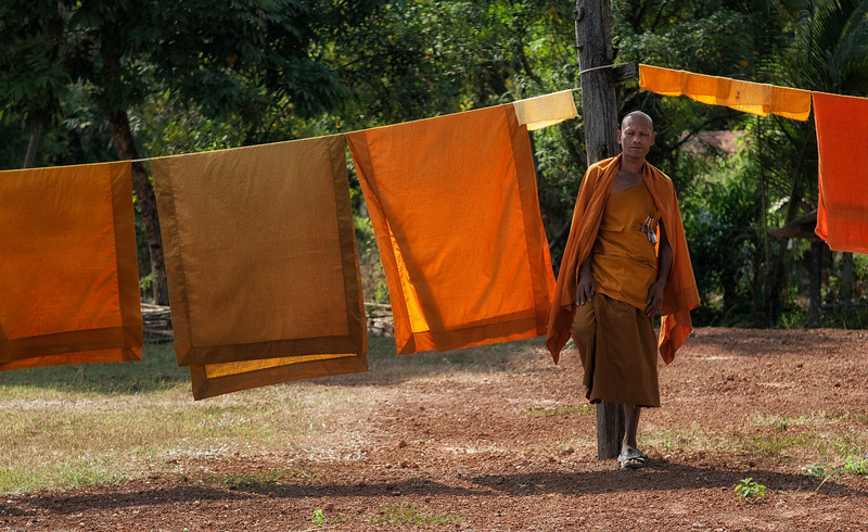 Monk hanging up the washing.<br /> <br /> Thailand,2012.