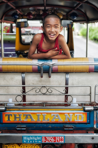 Boy on a tuk tuk.<br /> <br /> Bangkok, Thailand, 2012.