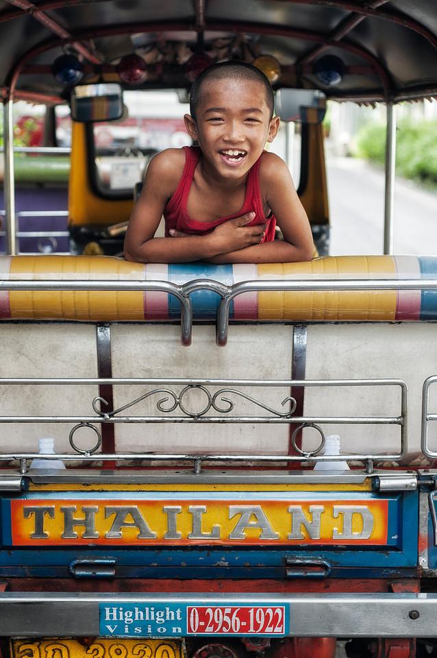 Boy on a tuk tuk.<br /> <br /> Bangkok, Thailand, 2012.