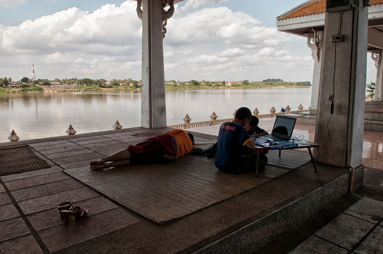 A family relaxing by the Mekong River.<br /> <br /> Nong Khai, Thailand, 2012.