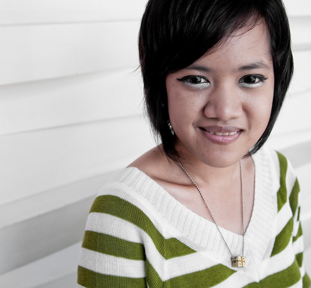 Modern city girl at an ice cream parlour.<br /> <br /> Bangkok, Thailand, 2010.