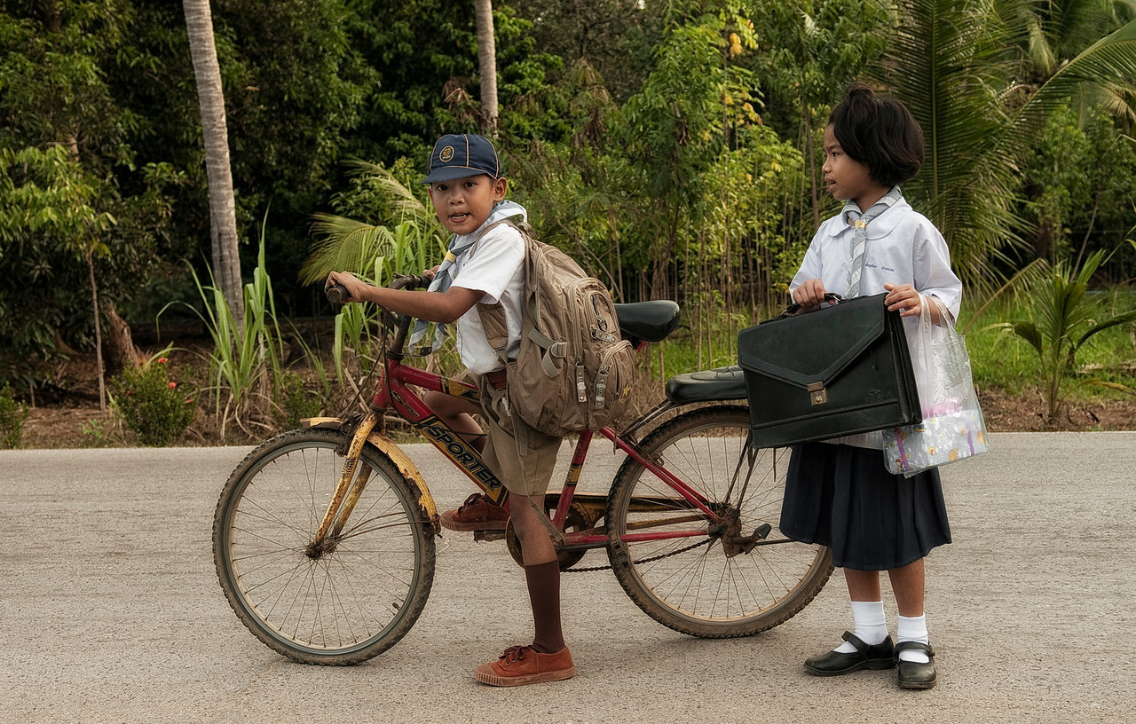 Kids on there way to school.<br /> <br /> Island of Ko Chang, Thailand, 2011.