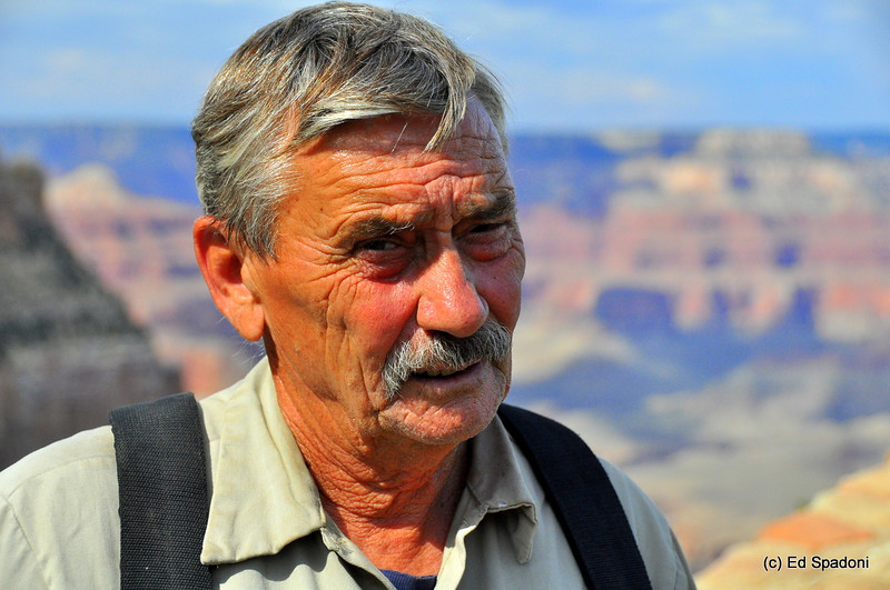 """Meet Harry<br /> <br /> While visiting the Grand Canyon, we had the pleasure of meeting Harry.  He has spent his life as a rancher, or as I prefer, a cowboy, working the ranches of the Southwest.  The ranch he had worked at for the past 12 years had closed due to the economy and he now works at Grand Canyon Village.<br /> <br /> After chatting with Harry a while, I asked if he'd mind if I took his picture.  He seemed surprised that anyone would want to do that, but said """"Well sure, if you want to.""""  I think this image captures the character of this man, and reflects the ruggedness of the geography and profession in which he has spent his life.<br /> <br /> We saw Harry again a few times during our visit, and he always gave us a warm smile and a friendly wave.  Meeting Harry was one of the many highpoints of our trip."""