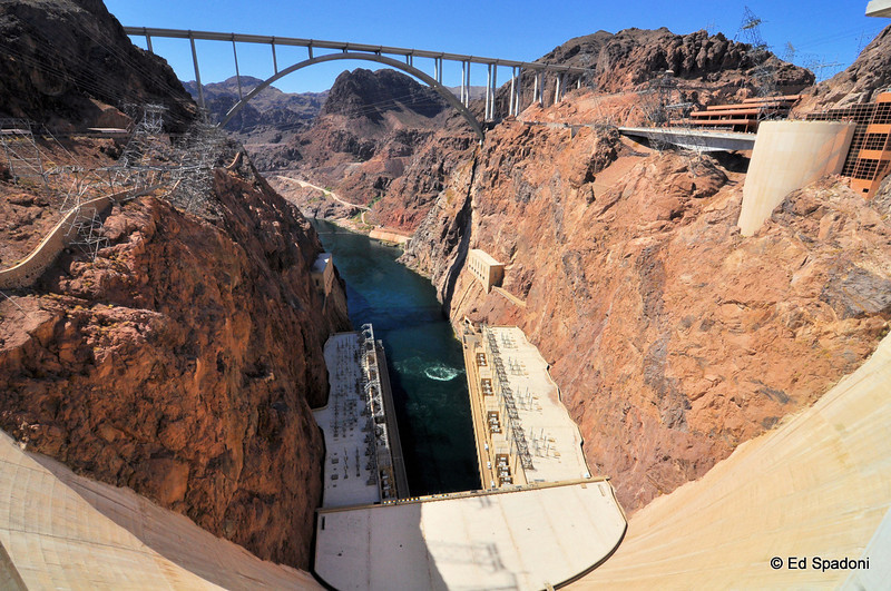 """The Hoover Dam and Bypass Bridge<br /> <br /> Taken with 11mm ultra-wide angle.<br /> <br /> Construction of the Colorado River Bridge is now complete!  The Colorado River Bridge is the central portion of the Hoover Dam Bypass Project. Construction on the nearly 2,000 foot long bridge (with a 1,060 foot twin-rib concrete arch) began in late January 2005 and traffic began using the Hoover Dam Bypass on October 19, 2010.  This signature bridge spans the Black Canyon (about 1,500 feet south of the Hoover Dam), connecting the Arizona and Nevada Approach highways nearly 900-feet above the Colorado River.   <a href=""""http://www.hooverdambypass.org/"""">http://www.hooverdambypass.org/</a>"""