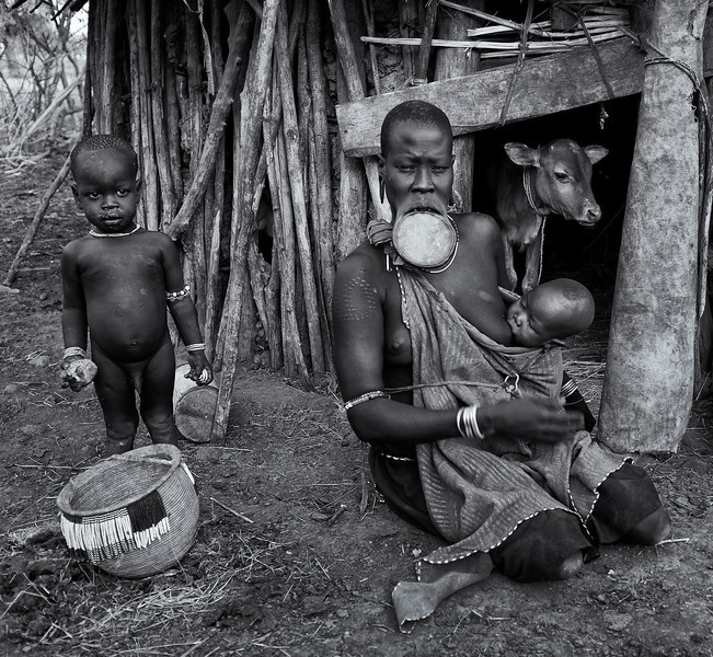 Murci woman and her children.<br /> <br /> Omo Valley, Southern Ethiopia, 2013.