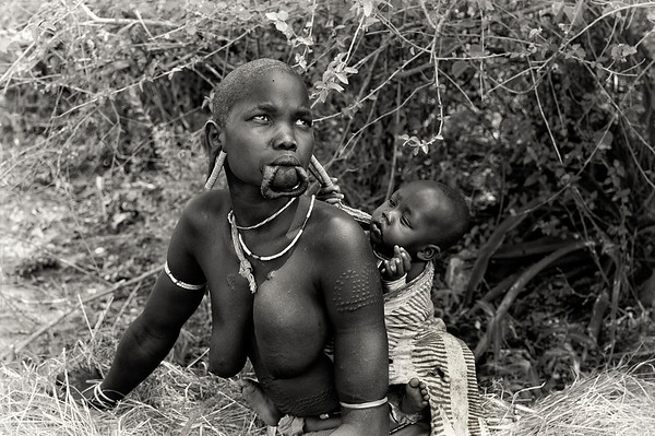 The supposed historical link between lip-plates and the activities of slave traders is an idea that goes back to colonial times. In an article in the September 1938 issue of National Geographic Magazine, C & M Thaw report meeting women with large plates in both their upper and lower lips near Fort Archambault, on the River Chari, about 400 miles south-east of Lake Chad, in what was then French Equatorial Africa.  Omo Valley, Southern Ethiopia, 2013.