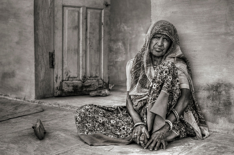 Woman relaxes in the shade in a small farming village outside Bundi.
