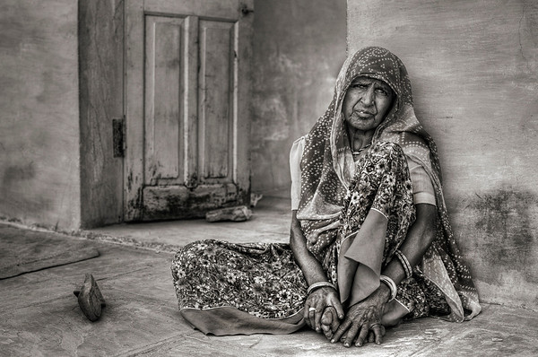 Woman relaxes in the shade in a small farming village outside Bundi.  Rajasthan, India, 2011.
