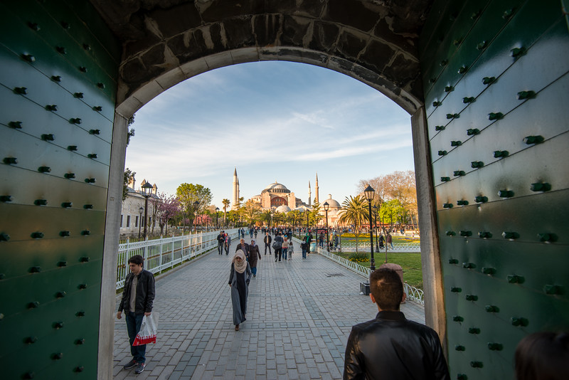 View looking outside from the Blue Mosque (Sultanahmet Camii). Sultan Ahmed Mosque is a historic mosque located in Istanbul, Turkey. A functioning mosque, attracting very large numbers of tourist visitors. It was constructed between 1609 and 1616 during the rule of Ahmed I. Its Külliye contains Ahmed's tomb, a madrasah and a hospice. Hand-painted blue tiles adorn the mosque's interior walls, and at night the mosque is bathed in blue as lights frame the mosque's five main domes, six minarets and eight secondary domes. It sits next to the Hagia Sophia, another popular tourist site.<br /> <br /> Istanbul, Turkey is a transcontinental city in Eurasia, straddling the Bosporus strait between the Sea of Marmara and the Black Sea.