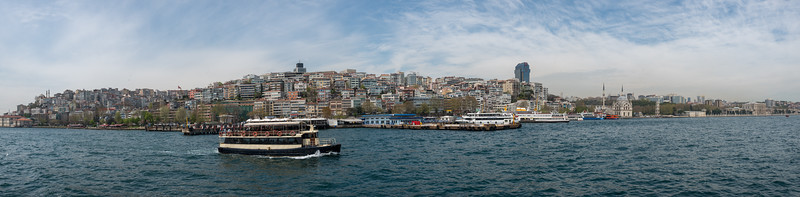 Bosphorus boat trip panoramic view.  The Bosporus or Bosphorus is a narrow, natural strait and an internationally significant waterway located in northwestern Turkey. It forms part of the continental boundary between Europe and Asia, and divides Turkey.
