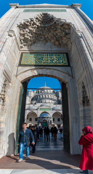 One of the panoramic entrance to the Blue Mosque (Sultanahmet Camii). Sultan Ahmed Mosque is a historic mosque located in Istanbul, Turkey. A functioning mosque, attracting very large numbers of tourist visitors. It was constructed between 1609 and 1616 during the rule of Ahmed I. Its Külliye contains Ahmed's tomb, a madrasah and a hospice. Hand-painted blue tiles adorn the mosque's interior walls, and at night the mosque is bathed in blue as lights frame the mosque's five main domes, six minarets and eight secondary domes. It sits next to the Hagia Sophia, another popular tourist site.<br /> <br /> Istanbul, Turkey is a transcontinental city in Eurasia, straddling the Bosporus strait between the Sea of Marmara and the Black Sea.