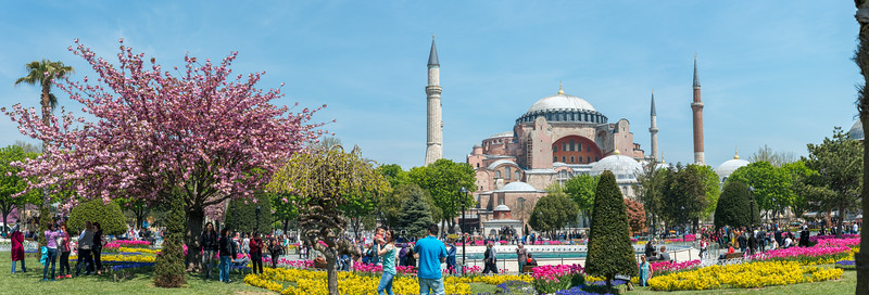 Panoramic view of Hagia Sophia, officially the Hagia Sophia Grand Mosque and formerly the Church of Hagia Sophia, is a Late Antique place of worship in Istanbul. Tourists and locals enjoy the streets of Istanbul, Turkey.