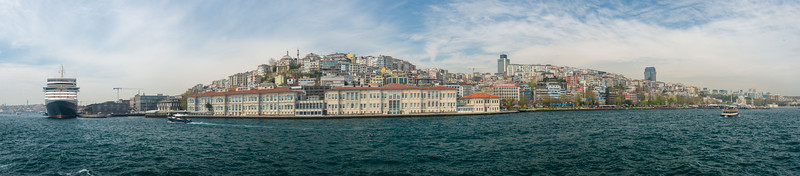 Panoramic vista during Bosphorus boat trip.  The Bosporus or Bosphorus is a narrow, natural strait and an internationally significant waterway located in northwestern Turkey. It forms part of the continental boundary between Europe and Asia, and divides Turkey.