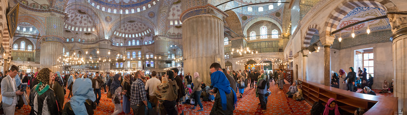 Panoramic view. Many tourists visit the Blue Mosque (Sultanahmet Camii). Sultan Ahmed Mosque is a historic mosque located in Istanbul, Turkey. A functioning mosque, attracting very large numbers of tourist visitors. It was constructed between 1609 and 1616 during the rule of Ahmed I. Its Külliye contains Ahmed's tomb, a madrasah and a hospice. Hand-painted blue tiles adorn the mosque's interior walls, and at night the mosque is bathed in blue as lights frame the mosque's five main domes, six minarets and eight secondary domes. It sits next to the Hagia Sophia, another popular tourist site.<br /> <br /> Istanbul, Turkey is a transcontinental city in Eurasia, straddling the Bosporus strait between the Sea of Marmara and the Black Sea.