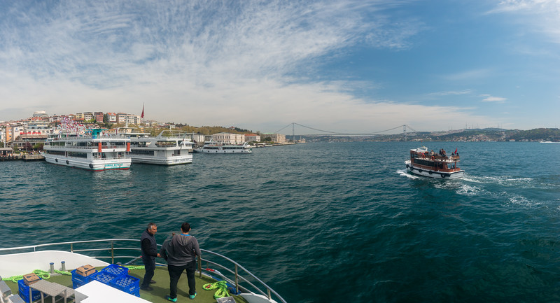 Panoramic view of the waters seen during Bosphorus boat trip.  The Bosporus or Bosphorus is a narrow, natural strait and an internationally significant waterway located in northwestern Turkey. It forms part of the continental boundary between Europe and Asia, and divides Turkey.