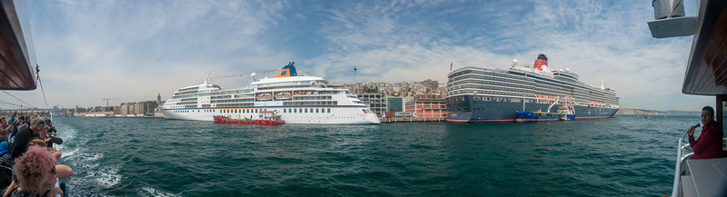 Panoramic view. Bosphorus boat trip.  The Bosporus or Bosphorus is a narrow, natural strait and an internationally significant waterway located in northwestern Turkey. It forms part of the continental boundary between Europe and Asia, and divides Turkey.