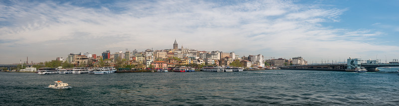 Bosphorus boat trip panoramic view of Dolmabahçe Palace.  The Bosporus or Bosphorus is a narrow, natural strait and an internationally significant waterway located in northwestern Turkey. It forms part of the continental boundary between Europe and Asia, and divides Turkey.