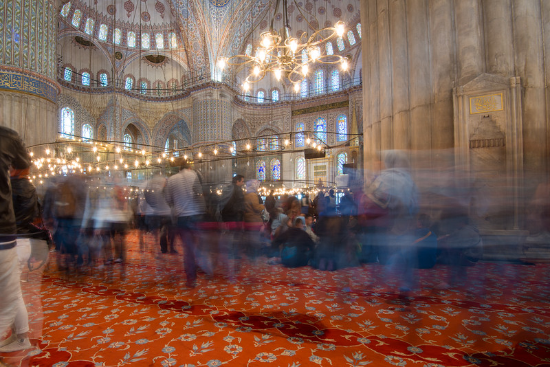 Many tourists visit the Blue Mosque (Sultanahmet Camii). Sultan Ahmed Mosque is a historic mosque located in Istanbul, Turkey. A functioning mosque, attracting very large numbers of tourist visitors. It was constructed between 1609 and 1616 during the rule of Ahmed I. Its Külliye contains Ahmed's tomb, a madrasah and a hospice. Hand-painted blue tiles adorn the mosque's interior walls, and at night the mosque is bathed in blue as lights frame the mosque's five main domes, six minarets and eight secondary domes. It sits next to the Hagia Sophia, another popular tourist site.<br /> <br /> Istanbul, Turkey is a transcontinental city in Eurasia, straddling the Bosporus strait between the Sea of Marmara and the Black Sea.