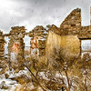 Old stone house ruins in falling snow - city of rocks