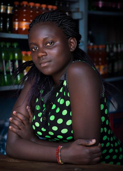 Shop attendant in the village of Nakiwogo, Uganda, 2016.