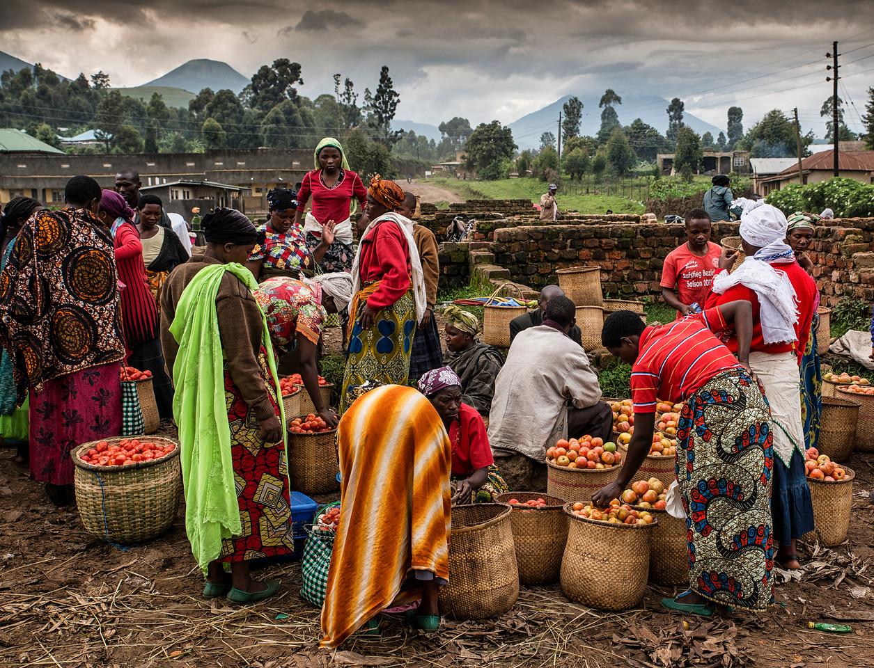 Food market in Kisoro, the volcanoes in the background mark the border with the Democratic Republic of Congo.<br /> <br /> kisoro, Uganda, 2016.