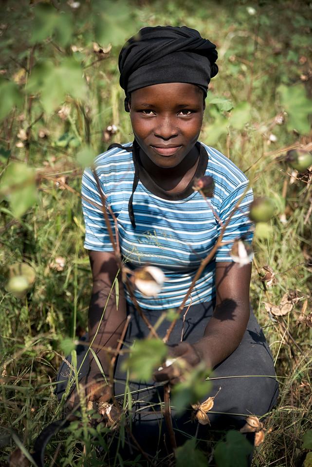 woman working in a cotton plantation.<br /> <br /> Uganda, 2016.
