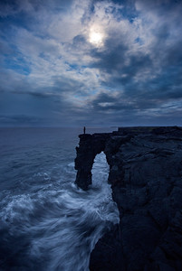 Waves crash into coastal lava cliffs, Hawaii