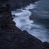 Waves crash into coastal lava cliffs, Hawaii