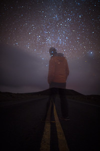Person stargazing from road, Hawaii