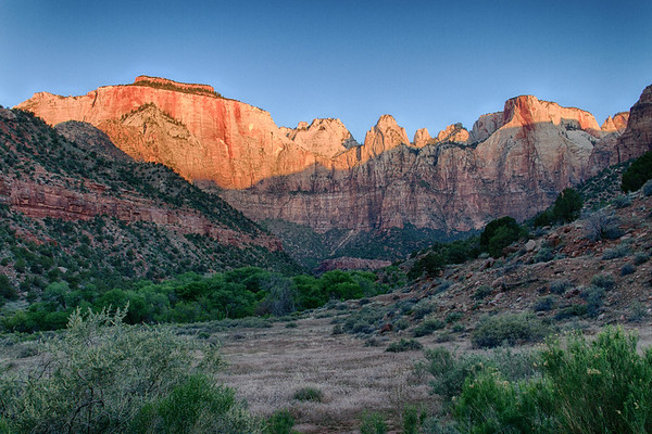 """Sunrise light on east-facing """"West Temple"""" (largest feature on the left with a sort of """"cap"""" on it)."""