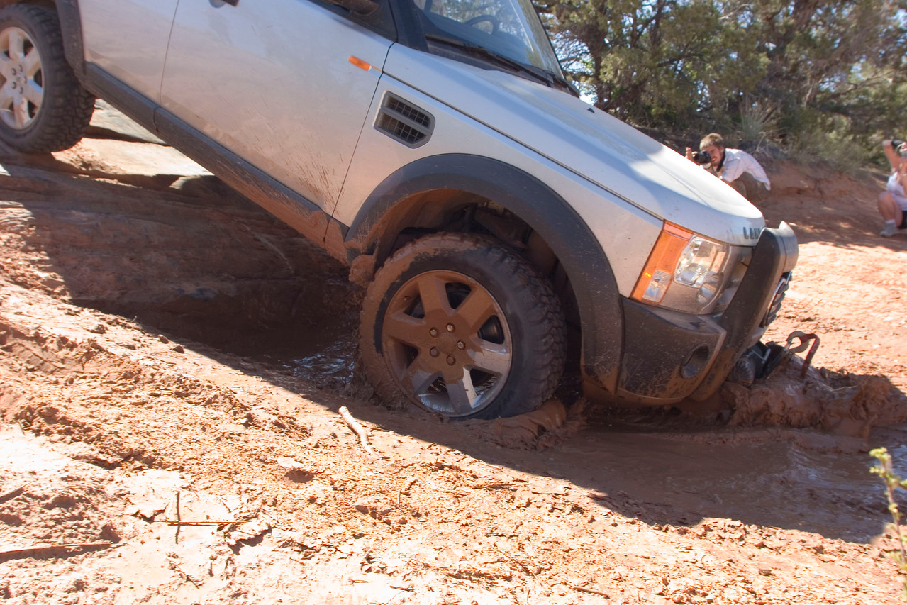 Ray Irvine plows some mud with his LR3 & winch. This downhill had a STEEP approach angle at the bottom