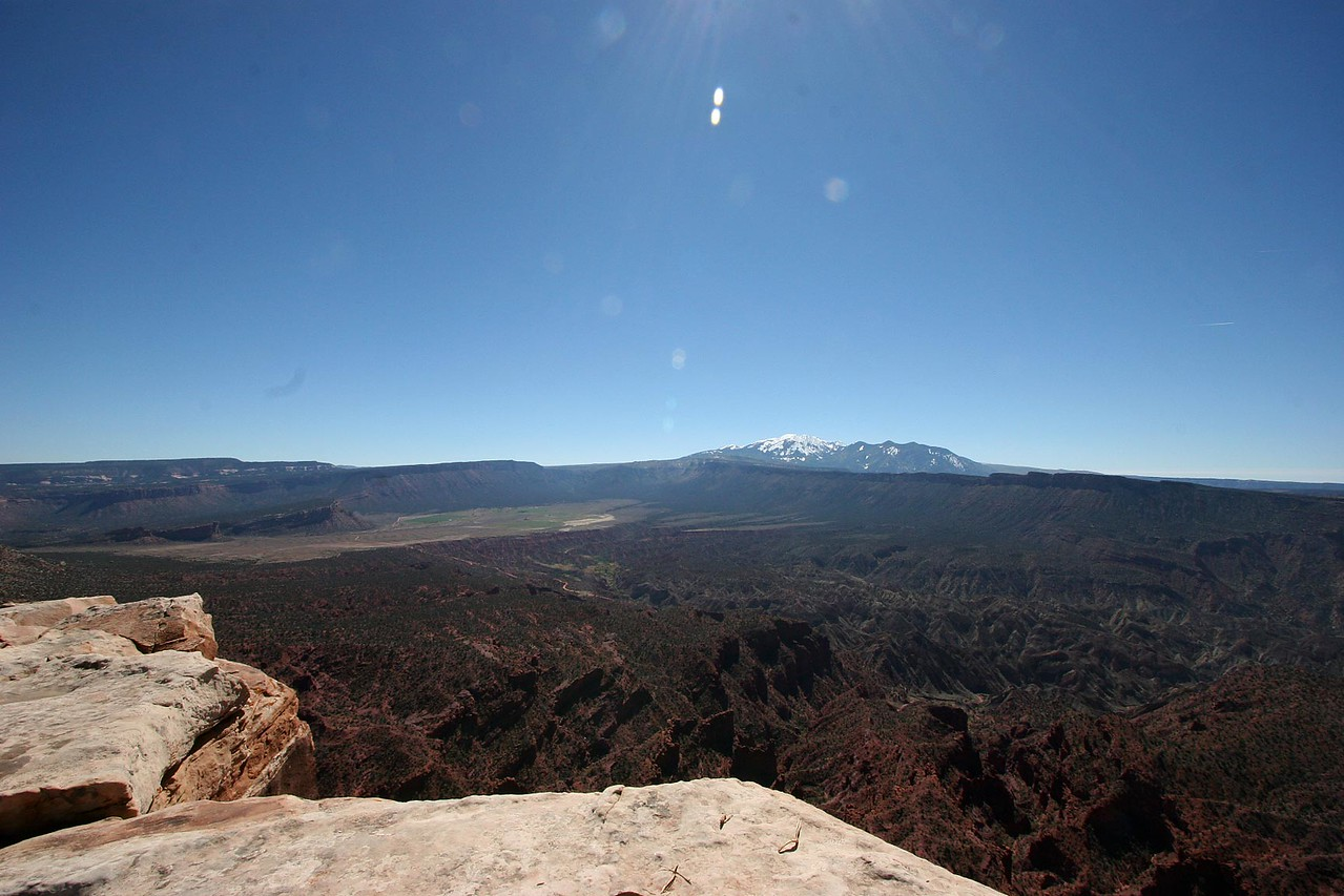 The La Sal mountains on the other side of the gulch before us.  That is one torturous landscape down below...