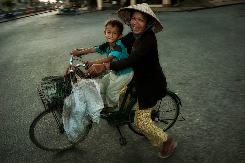 Mother and child on a bicycle.<br /> <br /> Rach Gia, Vietnam, 2008
