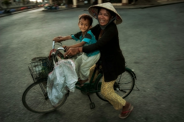 Mother and child on a bicycle.  Rach Gia, Vietnam, 2008