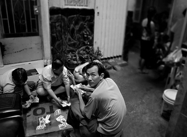 A game of cards is never to far away in the backstreet's of Saigon.  Vietnam, 2008.
