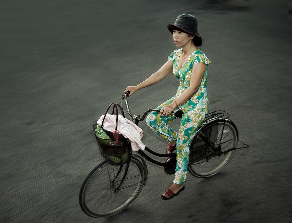 Office worker on her way to work<br /> <br /> Ninh Binh, Vietnam,2008