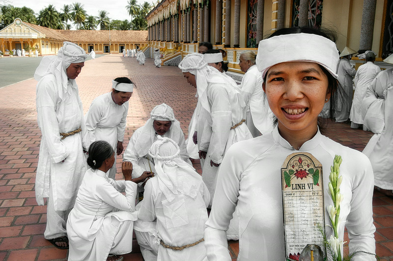 Worshipers gather outside the Cao Dai great Temple at Tay Ninh.<br /> <br /> North of Saigon, Vietnam, 2008