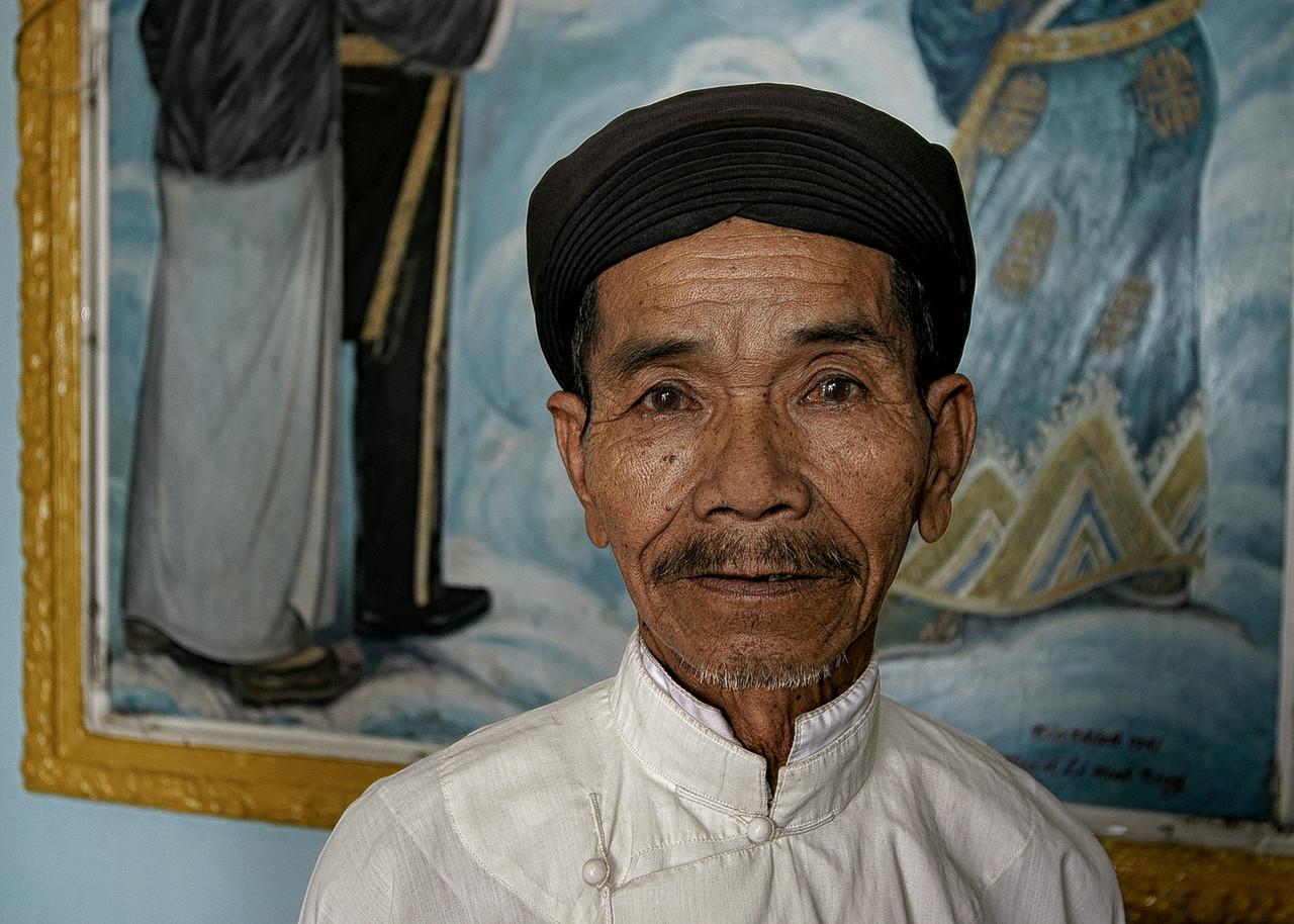 Worshiper at the Cao Dai great Temple.<br /> <br /> Tay Ninh, Vietnam, 2008.