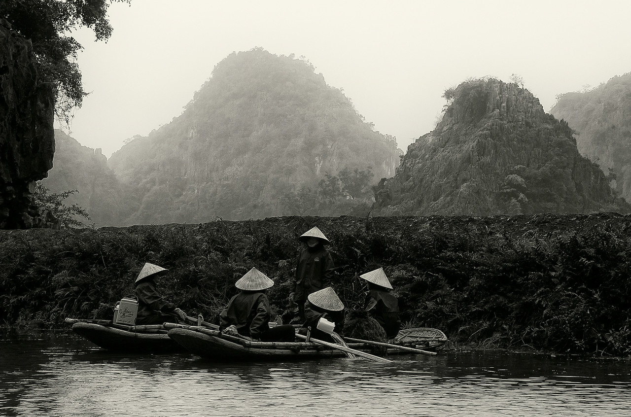 Women working in the rise paddies.<br /> <br /> Ninh Binh, Vietnam, 2008.