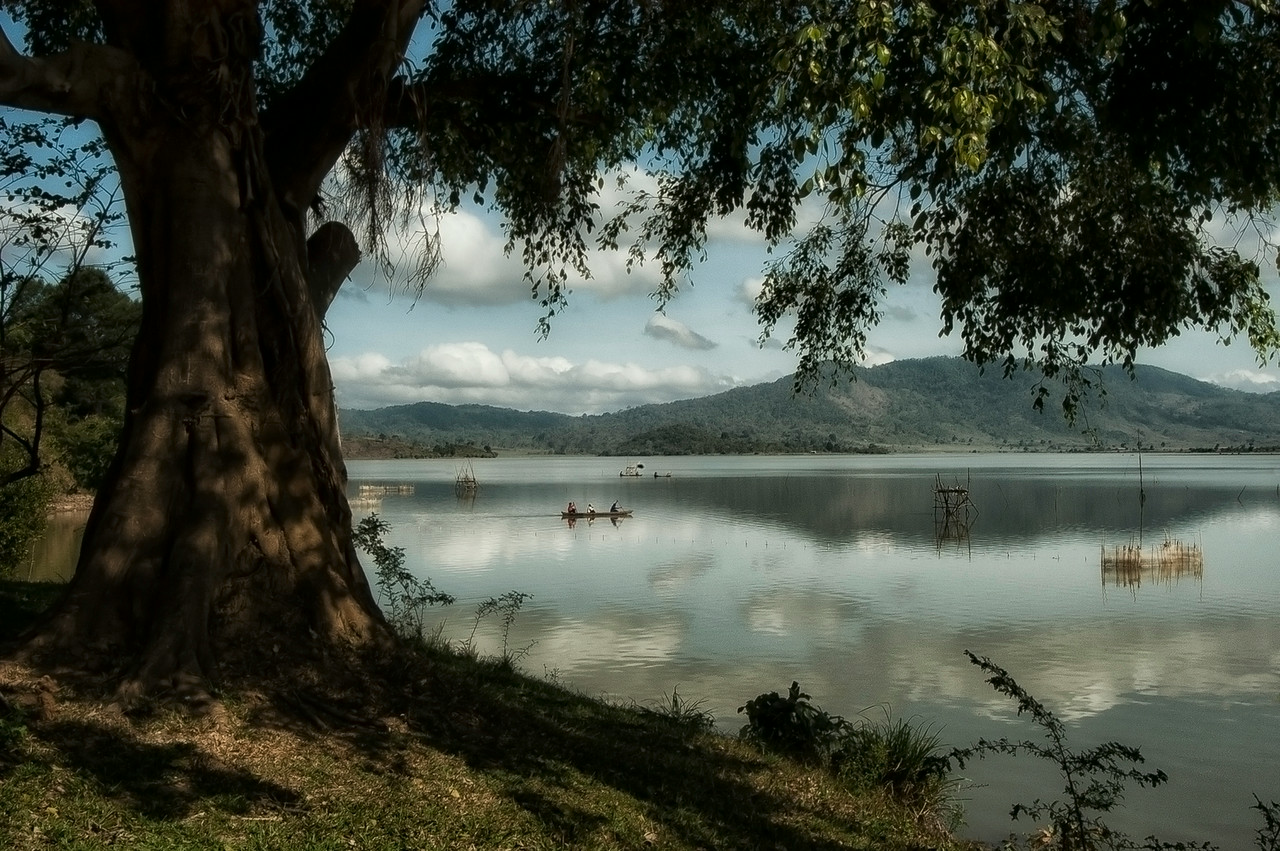 Lak Lake is as tranquil as it gets. Local fishermen casting there nets, elephants crossing the lake, locals riding a water buffalo or Mnong tribal people sitting outside there traditional long houses are all common sites in this part of Vietnam. <br /> <br /> Lak Lake, Vietnam, 2008