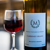 Enjoying at bottle at Morais Vineyards. Digital, 2014.