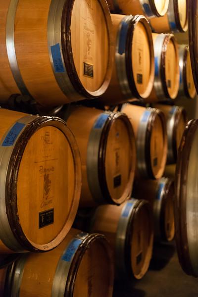 Looking at the barrels in the cellar room at Pearmund Cellars, Virginia. Digital,  2014.