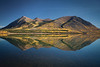 Nares Lake reflection in the fall, Carcross, Yukon, Canada.